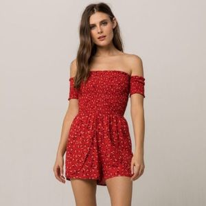 Red floral wrap romper
